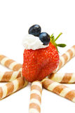 Strawberry and blueberry on white. Healthy fruits - strawberry and blueberry with chocolate waffles isolated on white background stock photography