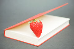 Strawberry in a book Royalty Free Stock Photography