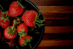 Strawberry in bowl black Royalty Free Stock Images