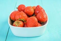 Strawberry Bowl On Blue Wood Royalty Free Stock Photos