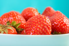 Strawberry Bowl On Blue Wood Royalty Free Stock Photography