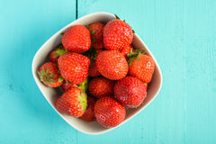 Strawberry Bowl On Blue Wood Royalty Free Stock Photo