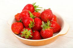 Strawberry in the bowl. Bright Strawberry in the bowl Stock Photography