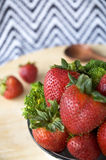 Strawberry in bowl with broccoli Royalty Free Stock Photos