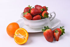 Strawberry bowl. A bowl full of red fresh strawberries with orange Stock Photo