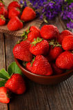 Strawberry in a Bowl on wooden background Stock Photo