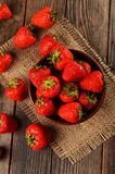 Strawberry in a Bowl on wooden background Royalty Free Stock Photos