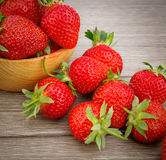 Strawberry in bowl on wooden Royalty Free Stock Images