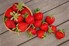 Strawberry in bowl on wooden Stock Photo