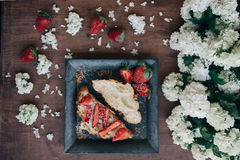Strawberry bread and flowers Stock Image