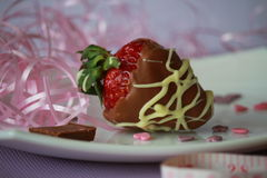 A strawberry with brown and white chocolate Royalty Free Stock Photography
