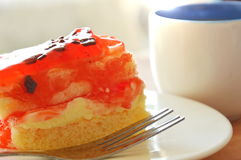 Strawberry butter cake topping chocolate chip with fork and coffee cup Royalty Free Stock Image