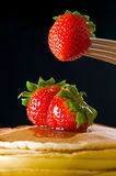 Strawberry butter pancake with honey Stock Photo