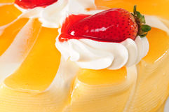 Strawberry cake. Orange cake covered with whipped cream and strawberry Royalty Free Stock Image