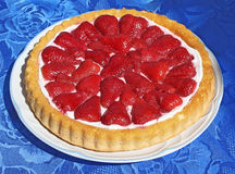 Strawberry Cake. On a plate over a blue tablecloth royalty free stock photography
