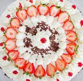 Strawberry cake. Closeup of a fresh strawberry cake with sliced strawberries and chocolate Stock Photography
