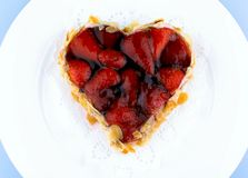 Strawberry cake with almond in heart shape Royalty Free Stock Photography