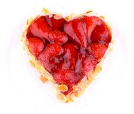 Strawberry cake with almond in heart shape Stock Images