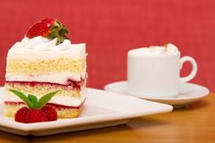 Strawberry cake with cappuccino Stock Images