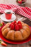 Strawberry cake. Strawberry cake with chocolate on wooden table royalty free stock photography