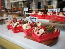 Strawberry cake on a counter show window in Portobello Market, Notting Hill royalty free stock photo