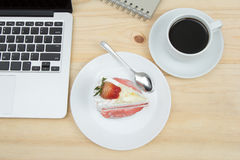 Strawberry cake and cup of coffee. Top view of strawberry cake and cup of coffee Royalty Free Stock Images
