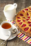 Strawberry cake, a cup of tea and milk Stock Images