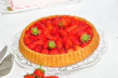 Strawberry cake. Delitious strawberry cake on white table Royalty Free Stock Images