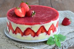Strawberry cake, Fraisier cake. On wooden background royalty free stock photography