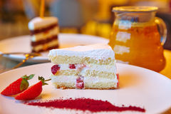 Strawberry cake, glass teapot, Royalty Free Stock Images