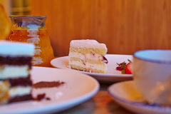 Strawberry cake, glass teapot Royalty Free Stock Photography