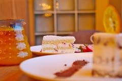 Strawberry cake, glass teapot Stock Photos