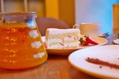 Strawberry cake, glass teapot, fruit tea Royalty Free Stock Photos