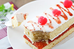 Strawberry cake with heart candies. Royalty Free Stock Photography