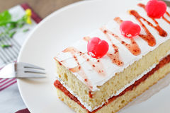 Strawberry cake with heart candy. Royalty Free Stock Photo