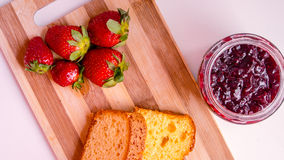 Strawberry cake and jam in a wood table cut Royalty Free Stock Image