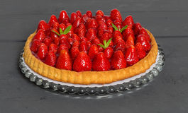 Strawberry cake with mint leaves on a anthracite wood Stock Photos