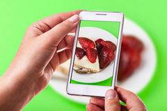 Strawberry cake phone photography Stock Photography