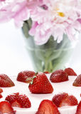 Strawberry cake and pink peonies in the vase Stock Images