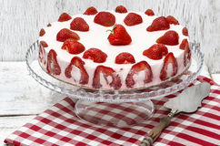 Strawberry cake on red and white table cloth Royalty Free Stock Photography