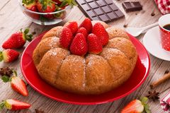 Strawberry cake. Strawberry cake with chocolate on red dish stock photography
