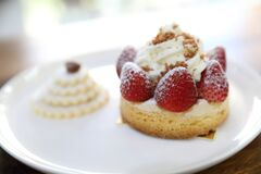 Strawberry cream cake on a plate