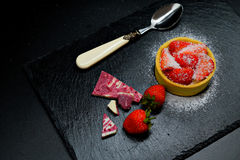Strawberry cake tart with cream and coconut chips and chocolate stock photo