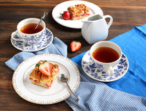 Strawberry cake and two cup of tea Royalty Free Stock Image