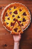Strawberry cake for Valentine`s Day with hearts on a wooden back Royalty Free Stock Photography