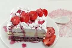 Strawberry cake with whipped cream Stock Photo