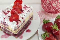 Strawberry cake with whipped cream Stock Images