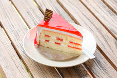 Strawberry cake in white dish on table Stock Image