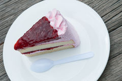 Strawberry cake on white plate with plastic spoon. Strawberry cake on white plate Stock Photo