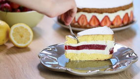 Strawberry Cake Woman eating sponge cake with strawberries and vanilla cream. Woman eating sponge cake with strawberries and vanilla cream stock footage